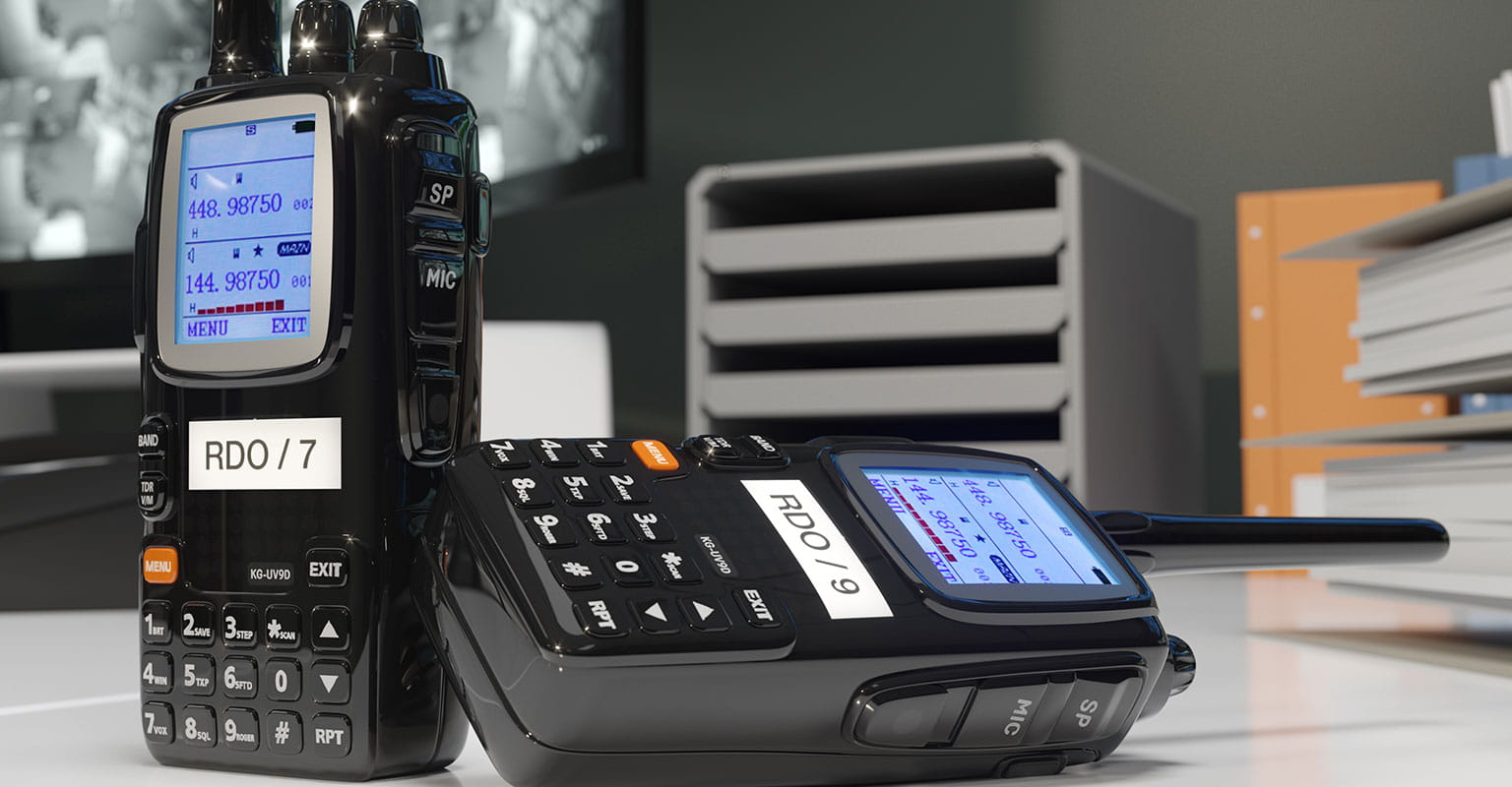 Two radio walkie-talkies with identification labels produced on a Brother P-touch label printer