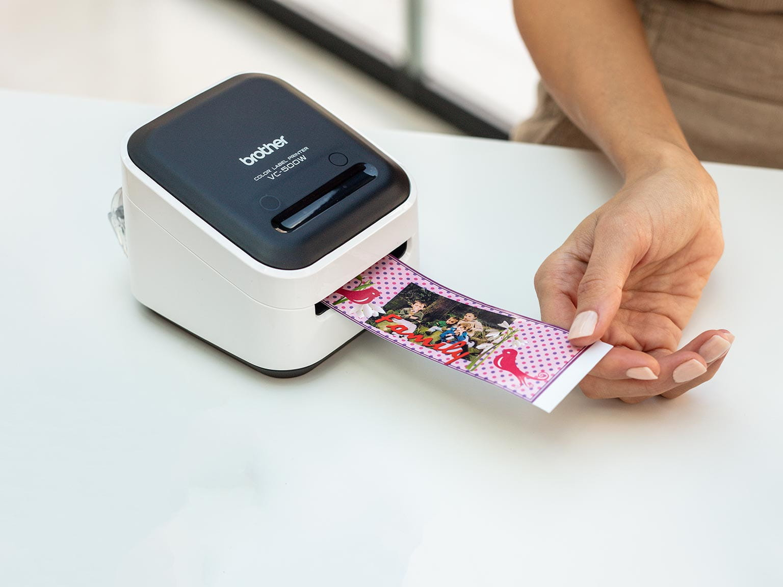 Brother colour label printer printing a wide label including clip art and photograph