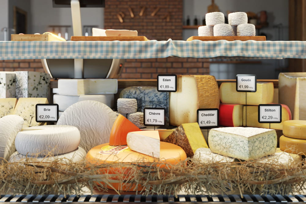 Deli counter with cheese labelled with Brother labels