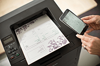 Image of a person printing a document from a mobile device